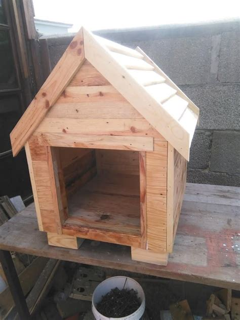 Build a Dog House from Pallets   Pallet dog house, Wooden