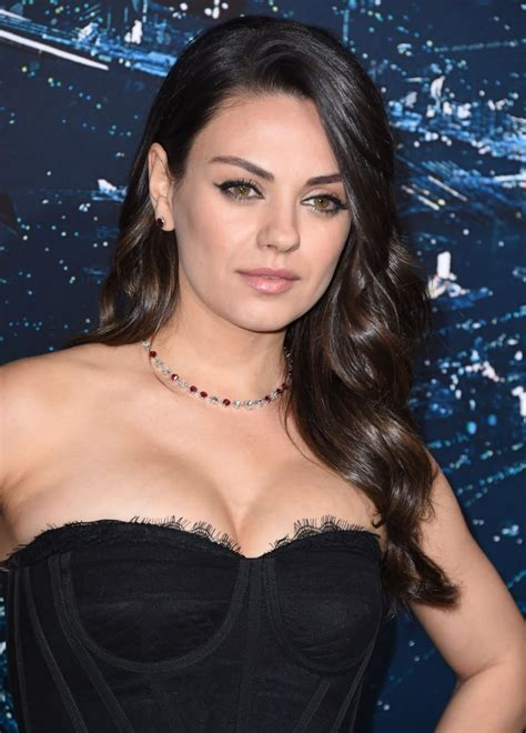 She Added Oomph in a Curve-Hugging Corset Top | Mila Kunis